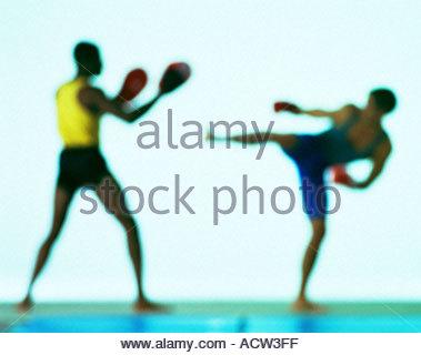 Two men kick boxing - Stock Photo