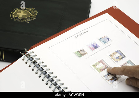 a Swiss stamp collection of stamps in an album - Stock Photo