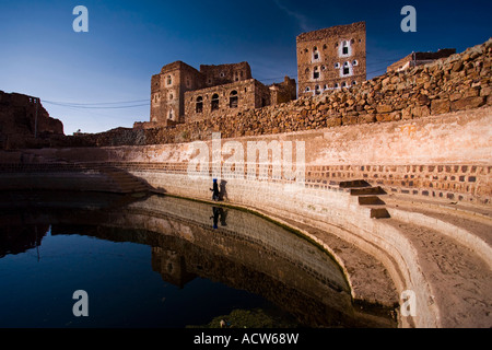 The cliffotop village of Shahara and its open air water cistern Haraz Mountains Yemen - Stock Photo