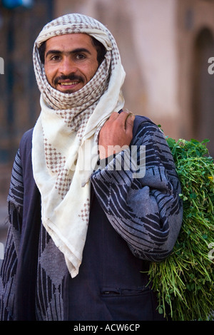 A fruit seller early in the morning along the streets of old Sanaa Yemen - Stock Photo