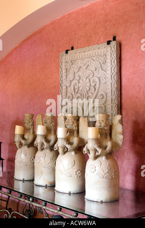 Ornate candle holders and artwork at the Melia Hotel in Colon Panama - Stock Photo