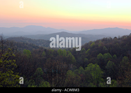 Layered mountains of the Smokies at sunrise from Ober Gatlinburg above the city of Gatlinburg Tennessee USA - Stock Photo