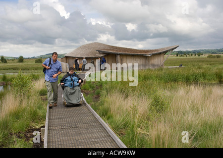 Cors Caron nature reserve Tregaron Ceredigion wales - observation hide with disabled woman in electric wheelchair - Stock Photo