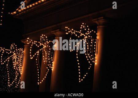 Illuminated angels on column - Stock Photo