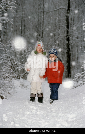 Children standing in a forest - Stock Photo