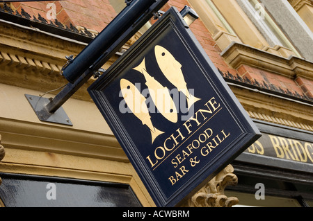Close up of Loch Fyne seafood bar and grill restaurant sign UK United Kingdom GB Great Britain - Stock Photo