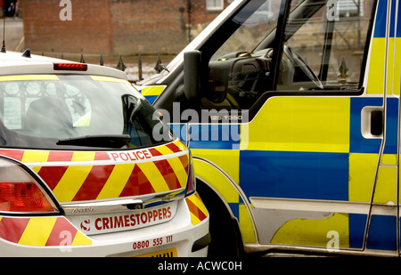 Parked police car and van UK United Kingdom GB Great Britain - Stock Photo