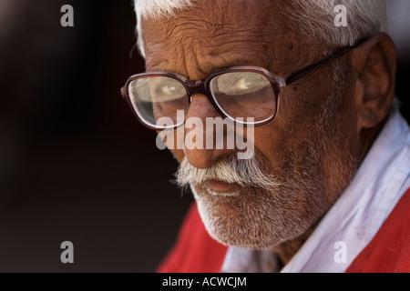 Heavily spectacled man Delhi India - Stock Photo