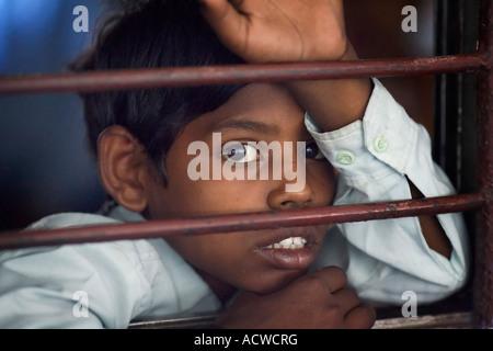 Boy in a train wagon Delhi India - Stock Photo