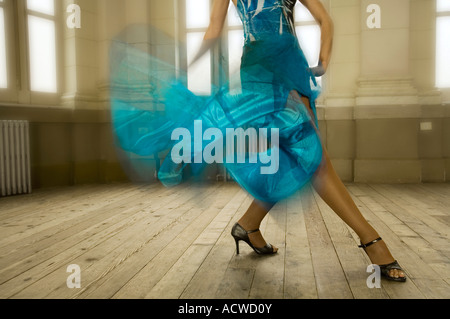 A woman dancer in a Blue dress in an old fashion dance hall - Stock Photo