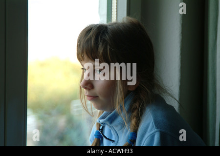 girl at the window - Stock Photo