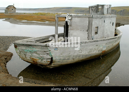 old fishing boat in the former whaling station Herschel Island Territorial Park Beaufort Sea - Stock Photo