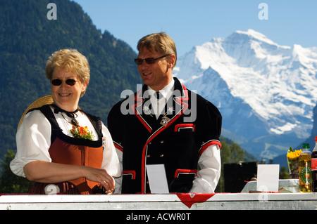 Switzerland Jungfrau Region Interlaken  Man and woman in Traditional Alpine Costume - Stock Photo