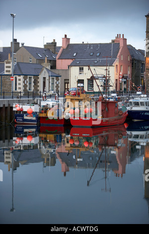Kirkwall Harbour Orkney Scotland Fishing boats and buildings reflected in Kirkwall Harbour at twilight - Stock Photo