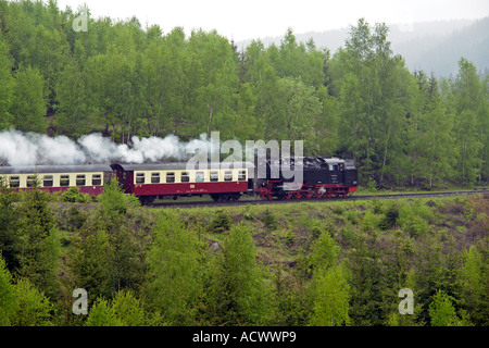 Harzer Schmalspurbahnen steam train on a curve leaving Drei Annen Hohne in the Harz Mountains for Brocken - Stock Photo