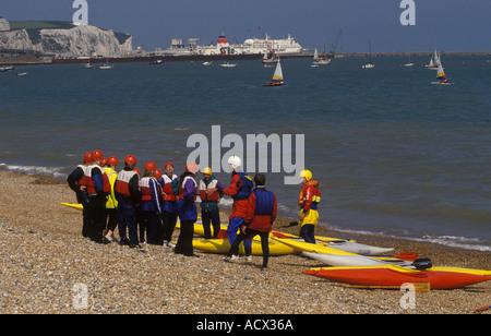 School children learning to canoe Dover Beach Kent England HOMER SYKES - Stock Photo