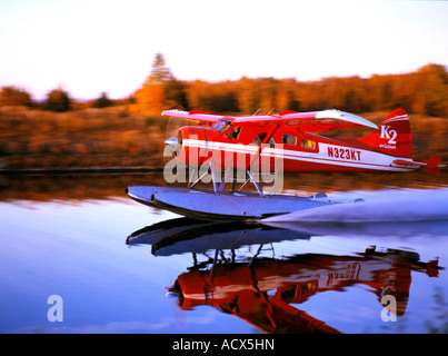 K2 Aviation Beaver on floats landing on Lake Hood Seaplane base in Anchorage on a fall evening - Stock Photo