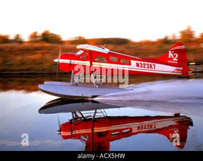 The K2 Aviation Beaver on floats landing on a fall evening - Stock Photo