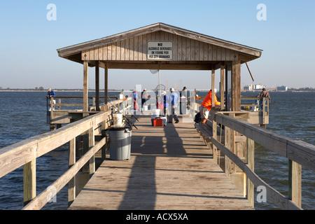 view along the pier on lighthouse beach sanibel island florida united states usa - Stock Photo