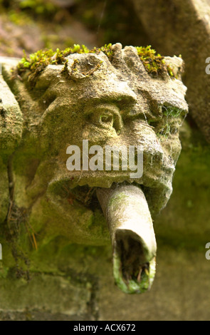 A GARGOYLE DOUBLING AS A RAIN WATER SPOUT ON LITTLEDEAN HALL IN THE FOREST OF DEAN GLOUCESTERSHIRE UK