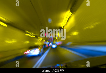 Cars In Traffic Through Tunnel With Motion Blur - Stock Photo
