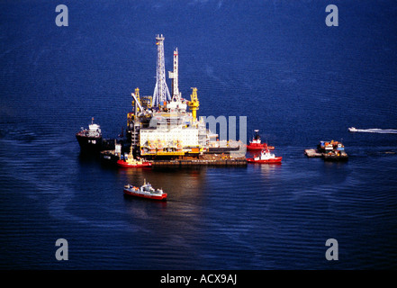 An aerial view of the Dutch Shell Draugen offshore oil drilling rig being transported to the North Sea Oil Field - Stock Photo