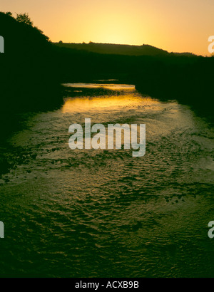 Sunset over a river; River South Tyne at 'Bridge End', near Hexham, Northumberland, England, UK. - Stock Photo