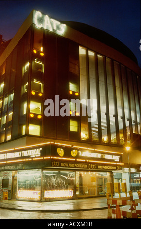 Illuminated night exterior shot of the New London Theatre with the theatre production of Cats showing up in illuminated - Stock Photo