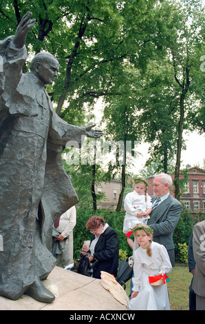 People at a statue of Pope John Paul II during the Corpus Christi procession, Poznan, Poland - Stock Photo