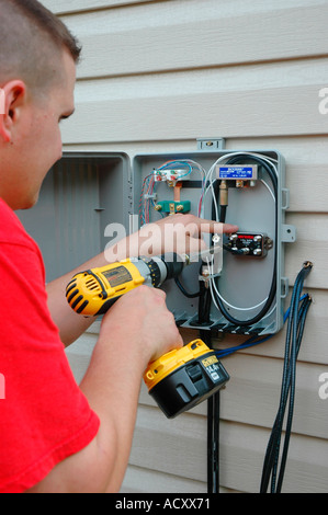 Installing cable TV and DSL lines and Phone lines on new house Stock ...