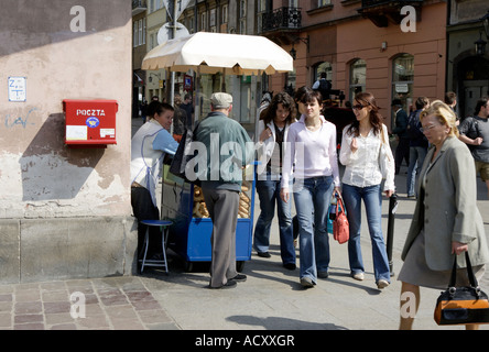 Street scene in the old town in Cracow, Poland - Stock Photo