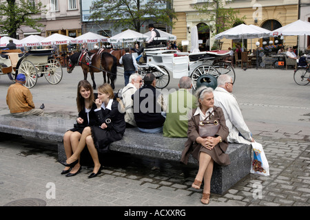 People in the Main Market Square in Cracow, Poland - Stock Photo