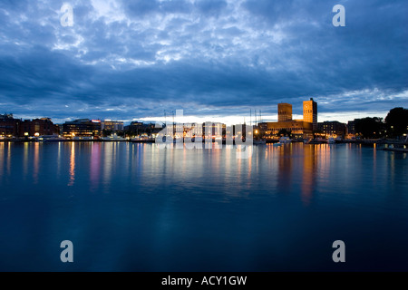 View from the waterside to the Akershus dock and Radhuset (City Hall of Oslo), Norway - Stock Photo