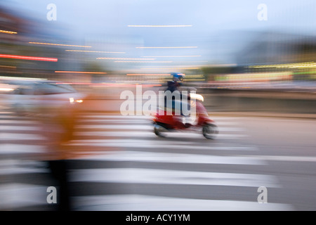 Speeding scooter on a zebra crossing, Spain - Stock Photo
