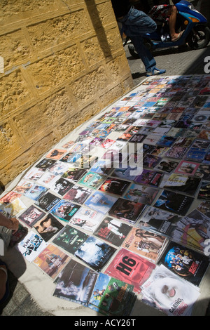 Illegal copies of music and movies for sale on a street in Cadiz, Spain - Stock Photo