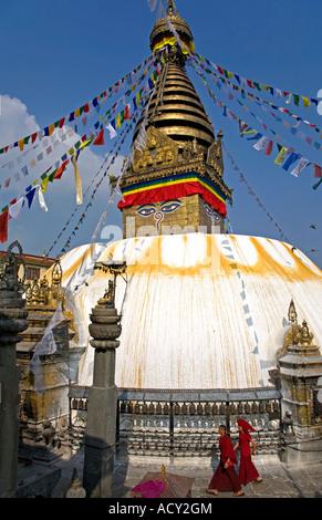 Tibetan monks circumambulating Swayambhunath Stupa.Kathmandu.Nepal - Stock Photo