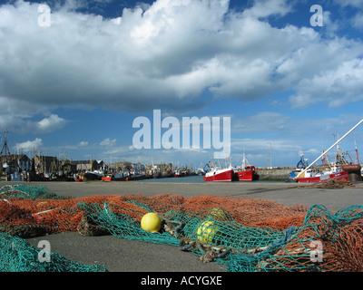Howth harbour, fishing village near Dublin Ireland under cumulus clouds - Stock Photo