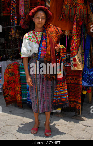 Indigenous woman selling textiles on the market in Chichicastenango, Guatemala, Central America - Stock Photo