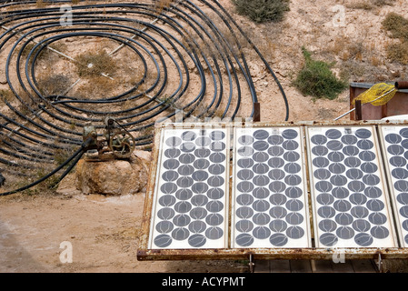 homemade solar energy sources and water heaters at an alternative energy farm using recycled materials - Stock Photo