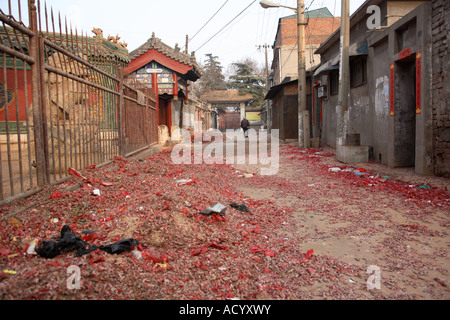 Red debris from fireworks let off in celebration of Chinese New Year Anyang Henan Province China - Stock Photo