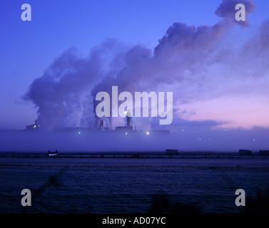 silhouette of smoke emitting from an irish industrial factory - Stock Photo