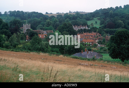 Pretty village of Hambleden, near Henley, with tower of St Mary the Virgin church, red roofs and flint cottages, - Stock Photo
