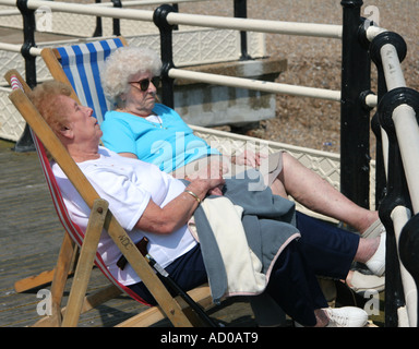 sleepy old ladies on seaside pier - Stock Photo