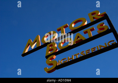 Motor boats sightseeing sign against deep blue cloudless sky, Stockholm, Sweden. - Stock Photo