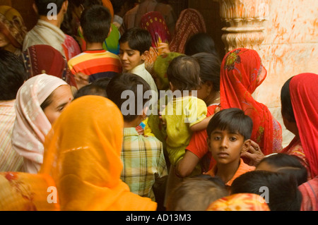 Horizontal view of a group of Indian people queueing at the altar at the Karni Mata 'Rat' Temple in their bright - Stock Photo