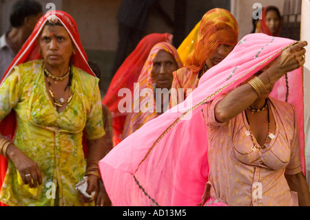 Horizontal portrait of a group of Indian women in colourful saris at the Karni Mata Temple 'Rat Temple' at Deshnoke. - Stock Photo