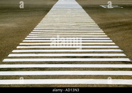 Horizontal close up of a huge zebra crossing painted on the wide Rajpath road. - Stock Photo