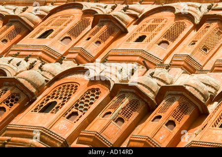 Horizontal angular close up of the windows on the front facade of the 'Hawa Mahal', Wind Palace, in Jaipur. - Stock Photo