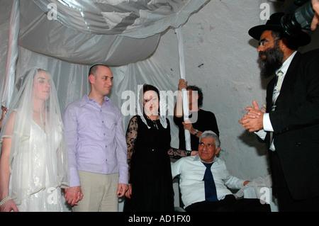 Jewish wedding Israel couple under the Hupa - Stock Photo