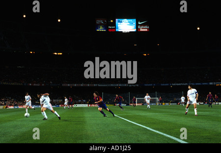 Barcelona Football Club playing at the Nou Camp stadium, Europe's largest footballing arena. - Stock Photo